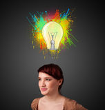 Young woman thinking with lightbulb above her head Royalty Free Stock Image