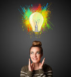 Young woman thinking with lightbulb above her head Stock Photos