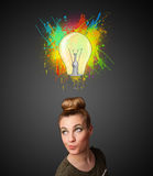 Young woman thinking with lightbulb above her head Royalty Free Stock Photos
