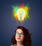 Young woman thinking with lightbulb above her head Stock Images