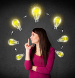 Young woman thinking with lightbulb circulation around her head Royalty Free Stock Image