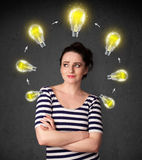 Young woman thinking with lightbulb circulation around her head Stock Images