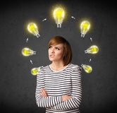 Young woman thinking with lightbulb circulation around her head Stock Photo