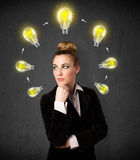 Young woman thinking with lightbulb circulation around her head Royalty Free Stock Photos