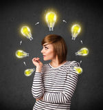 Young woman thinking with lightbulb circulation around her head Royalty Free Stock Photography