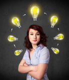 Young woman thinking with lightbulb circulation around her head Royalty Free Stock Images