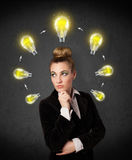 Young woman thinking with lightbulb circulation around her head Stock Image