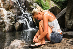 Young Woman thinking. Outdoors in tropical forest near waterfall Stock Photos