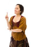 Young woman thinking and pointing up Royalty Free Stock Photo