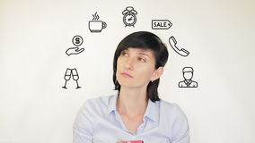 Young woman thinking about productivity on a white background stock footage