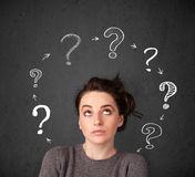 Young woman thinking with question mark circulation around her h stock photography