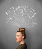 Young woman thinking with sketched arrows above her head Stock Photography
