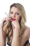 Young Woman Thinking Smoking a Cigarette Stock Photography