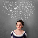 Young woman thinking with social network icons above her head Stock Photos