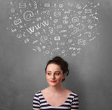 Young woman thinking with social network icons above her head Stock Images
