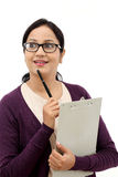 Young woman thinking while taking notes Royalty Free Stock Photos