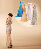 Young woman thinking which dress to wear on New Year's party . Royalty Free Stock Photo