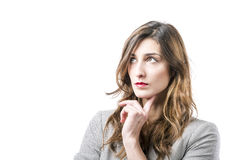 Young woman thinking. On white background Stock Images