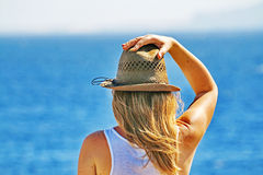 A young woman thoughtfully looks at a sea royalty free stock image