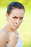 Young woman threatens Royalty Free Stock Photos