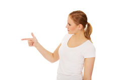 Young woman threatens someone the finger Royalty Free Stock Photography