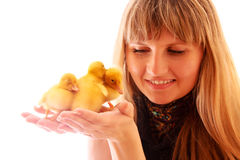 Young woman with three ducklings Stock Photography
