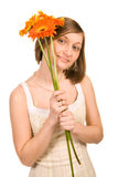 Young woman with three gerberas Royalty Free Stock Photos