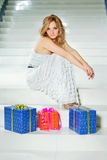 Young woman with three gifts Stock Photos