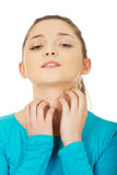 Young woman with a throat pain. Stock Image