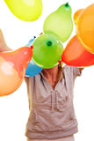 Young woman throwing balloons Royalty Free Stock Images