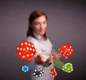 Young woman throwing dices and chips Royalty Free Stock Photos