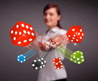 Young woman throwing dices and chips Stock Image