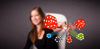 Young woman throwing dices and chips Royalty Free Stock Image