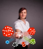 Young woman throwing dices and chips Royalty Free Stock Photography