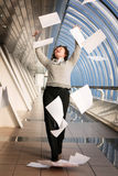 Young woman throwing documents Stock Photography