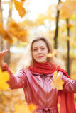 Young woman throwing leaves Stock Photo