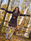 Young woman throwing leaves in the air Stock Images