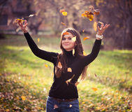 Young woman throwing leaves woman Royalty Free Stock Photo