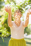 Young woman throwing little leafs Royalty Free Stock Photos