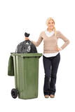 Young woman throwing out the trash Royalty Free Stock Images