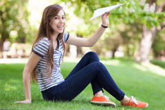 Young woman throwing paper plane Royalty Free Stock Photo