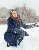 Young woman throwing snow in air Stock Image