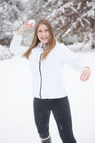 Young woman throwing snow ball. Stock Photos