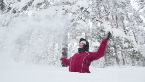 Young woman throwing snow up stock video