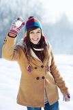 Young woman throwing snowball. Winter collection: young woman throwing snowball Stock Image