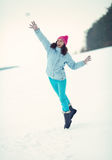 Young woman throwing snowball Royalty Free Stock Photo