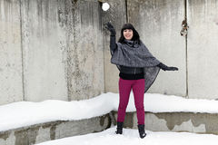 Young woman throwing a snowball Royalty Free Stock Photography