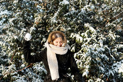 Young woman throwing snowball Royalty Free Stock Photos