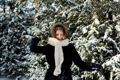 Young woman throwing snowball Royalty Free Stock Image