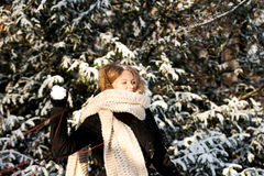 Young woman throwing snowball Royalty Free Stock Images